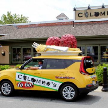 The yellow Colombos To Go car with spaghetti and meatballs on top